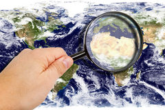 Maginfier with world map - earth texture by NASA.gov stock photo