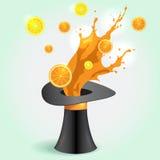 Magische hoed whith oranje Juice Splash Stock Afbeelding
