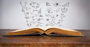 Magisches Buch mit Geschäft cencept Stockfoto
