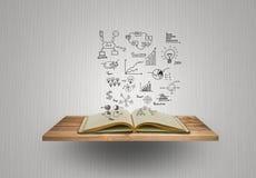 Magisches Buch mit Geschäftskonzept und -diagramm Stockbild