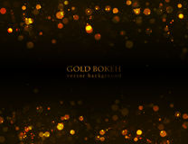 Magisk gnistrande, guldprickar på mörk bakgrund Arkivbild