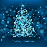 Magisk julgran på blå bakgrund Arkivbilder