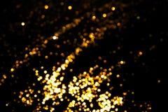 Magisk ljusjulbokeh på svart bakgrund arkivfoton
