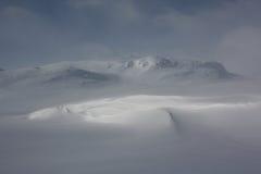 Magiskt ljus i Jotunheimen vinterlandskap, Norge fotografering för bildbyråer