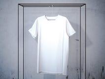 Maglietta bianca in bianco sul gancio moderno rappresentazione 3d illustrazione di stock