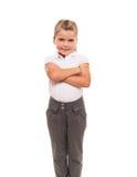 Maglietta bianca d'uso e pantaloni della bambina allegra isolati sopra Fotografie Stock