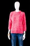 Maglietta felpata rosa con le blue jeans Fotografia Stock
