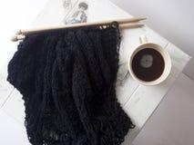 Maglione nero tricottato Fotografie Stock