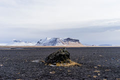 Magma rock plain with mountains in the background Royalty Free Stock Photos