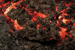 Magma textured molten rock surface. Formation geology nature environment Volcano, fire, crust. Lava flame on black ash background. Danger, hazard, energy Stock Photography