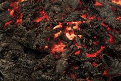 Magma textured molten rock surface. Lava flame on black ash background. Formation, geology, nature, environment. Danger, hazard, energy concept Volcano fire Royalty Free Stock Images