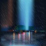 Magmas de pluie sur la rue Photographie stock libre de droits
