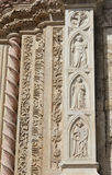 Magnanimity and Pride from Palazzo dei Priori in Perugia, Italy. Two medieval relief symbolize Magnanimity and Pride from the Palazzo dei Priori portal, in the Stock Image