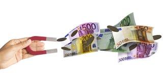 Magnes przyciąga pieniądze zdjęcia royalty free