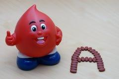 Magnesio ferroso del fumarato 200 con las vitaminas para el tipo A del donante de sangre fotos de archivo libres de regalías
