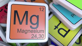 Magnesium block on the pile of periodic table of the chemical elements blocks. Chemistry related 3D rendering Royalty Free Stock Photo
