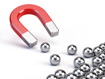 Magnet attract spheres. Business concept - Magnet attract spheres Royalty Free Stock Photography