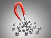 Magnet attracting chrome bearing ball. Royalty Free Stock Photography