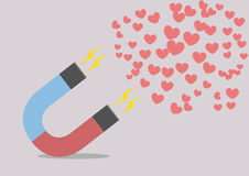 Magnet attracting hearts Stock Images