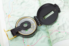 Magnet compass on map Stock Images