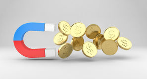 Magnet draws the coins Stock Photos