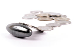 Magnet with money. Magnet with coins on white Stock Photos