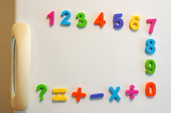Magnet numbers. On fridge door stock photos