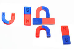 Magnet. Red horseshoe magnet isolated on white background Stock Images