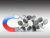 Magnet with silver coins Royalty Free Stock Images