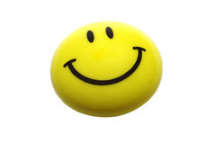 Smiley face smiles smile icon magnet isolated on white background plastic pin emoticon emoji emotions yellow close up closeup shot. Yellow smiling magnet stock photo