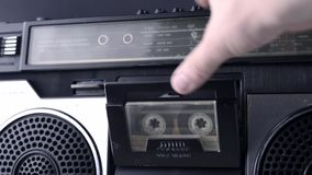 Magnet tape cassette start. Set magnet tape cassette into vintage deck and start playing stock video