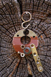 Magnet On The Wall. Magnet on the cracked log with attracted metal items Royalty Free Stock Photos