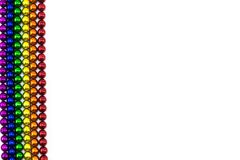Magnete variopinto delle sfere nella linea dell'arcobaleno su un contesto bianco Immagine Stock Libera da Diritti