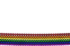 Magnete variopinto delle sfere nella linea dell'arcobaleno su un contesto bianco Fotografia Stock