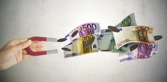 Magneten tilldrar pengar arkivfoton