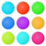 Magneter knappar färgar på en vit bakgrund Royaltyfri Foto