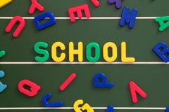 Magnetic board. The word school on a magnetic board Stock Photography