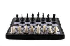 Magnetic chess. Chess pieces on the board, isolated on white Stock Images