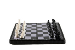 Magnetic chess. Chess pieces on the board, isolated on white Stock Photos