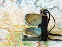 Magnetic compass. Trip or travel concept with map and compass stock photos