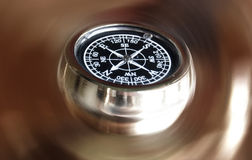 Magnetic compass. A view of the face of a magnetic compass on a blurred brownish background Royalty Free Stock Photos
