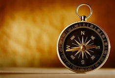 Magnetic compass against a vintage background Royalty Free Stock Photography