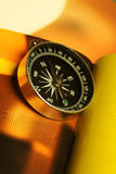 Magnetic compass on a colorful background Royalty Free Stock Images