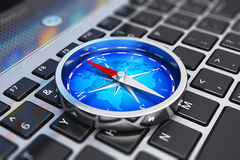 Magnetic compass on laptop keyboard Royalty Free Stock Image