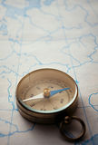 Magnetic compass lying on a map Stock Photo