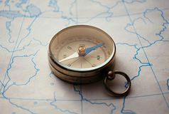 Magnetic compass lying on a map Royalty Free Stock Photography