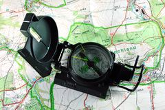 Magnetic compass with map Stock Photo