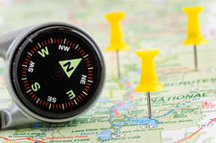 Magnetic Compass on a Map Royalty Free Stock Images