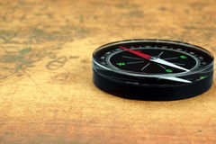 Magnetic Compass On The Old Map Stock Images