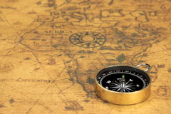 Magnetic Compass On The Old Map Royalty Free Stock Photography